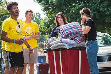 Students moving into a residence hall