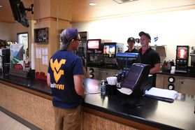 Student ordering in diner from Summit Hall