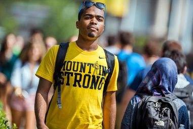 Student walking on WVU campus summer