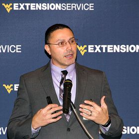 Tony Michael talks about the WVU Extension Service with a crowd.