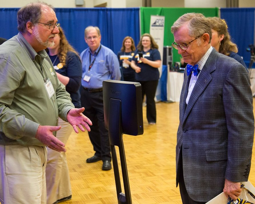 President Gee looking at the Beam Telepresence robot