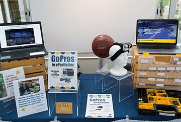 presentation table with tablets showing go pro camera footage