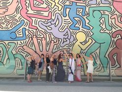 students posing in front of Toto Mundo mural