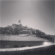 black and white photo of ancient buildings in Siena