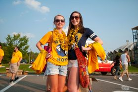 Two female students in gameday attire