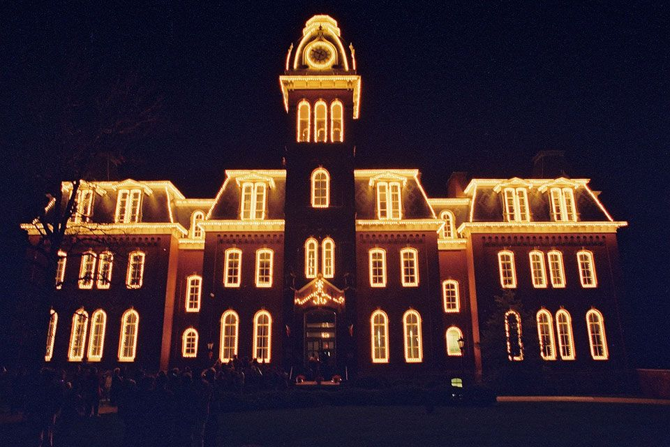 Choir singing in front of Woodburn Hall