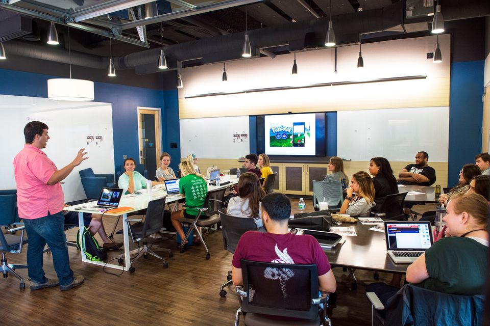 College of Media Professor Bob Britten instructs his class in the Media Innovation Center