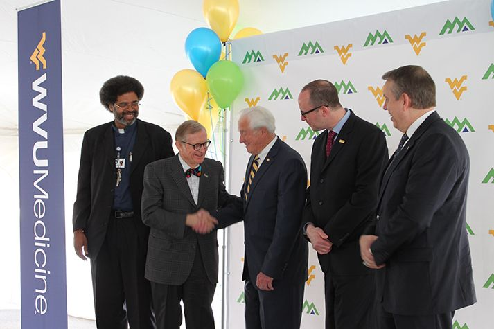 President Gordon Gee shaking hands during a photo opportunity at a WVU Medicine event