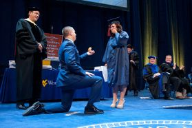 Kneeling graduate proposes to girlfriend