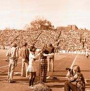 Sideline action at old Mountaineer Field