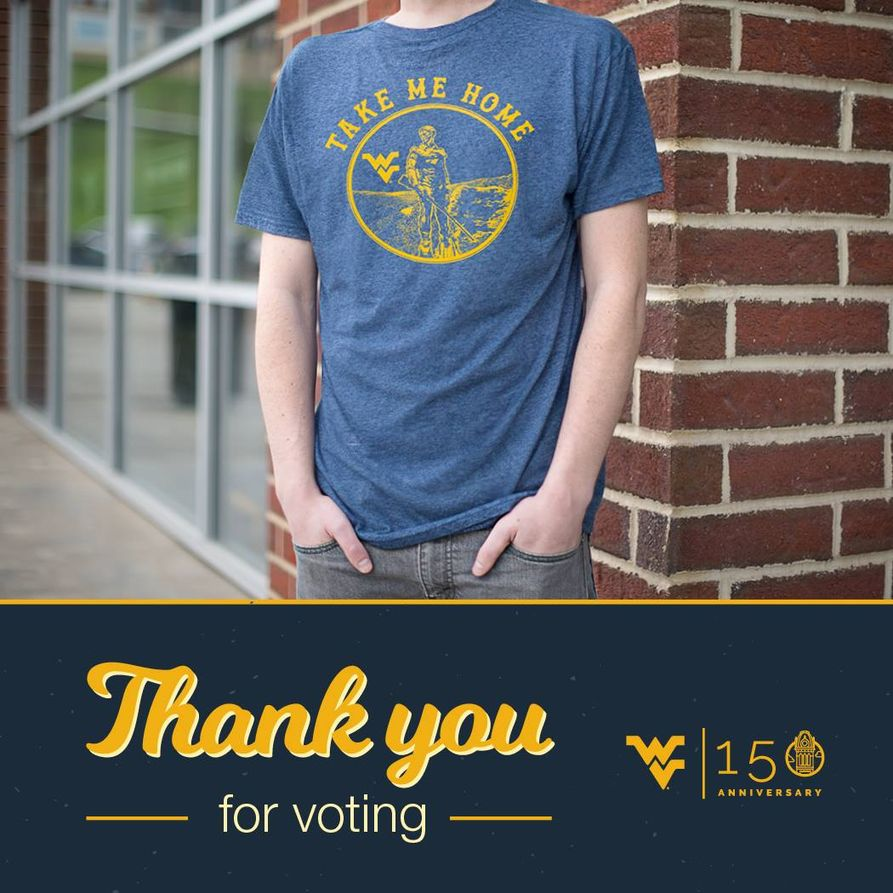 "Student wearing the winning shirt. The winning shirt is blue with a gold emblem on the front containing the Mountaineer and the Flying WV. Around the emblem are the words ""Take Me Home"". Thank you for voting."