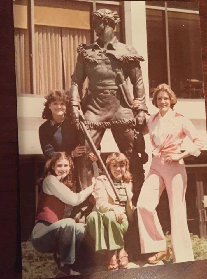 Female students with Mountaineer statue