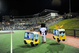 People wearing PRT costumes race at Mon County Ballpark