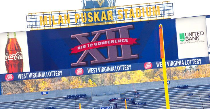 Scoreboard at Milan Puskar Stadium with the Big 12 logo