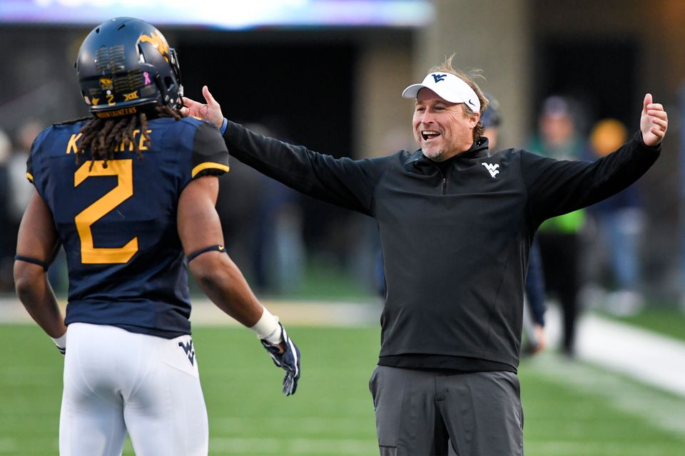 WVU coach Dana Holgorsen getting ready to embrace a player after a big play