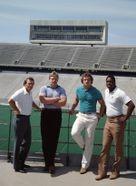 Football Coach Don Nehlen with players at Mountaineer Field