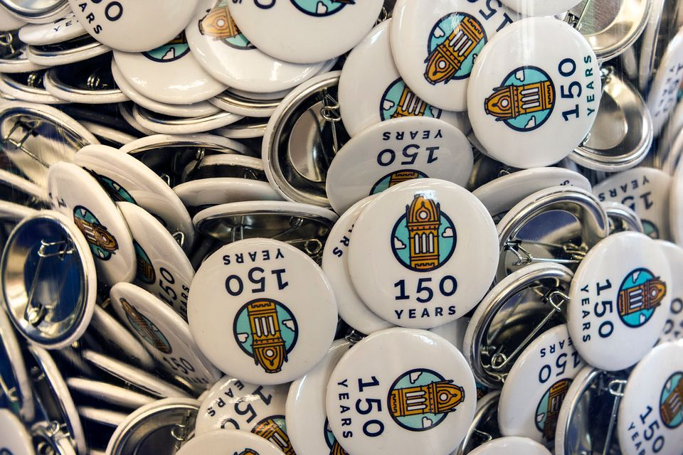 Pile of WVU 150th birthday celebration buttons