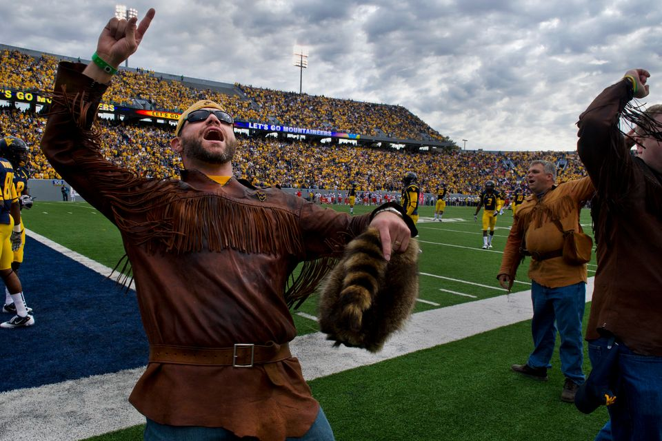 A former Mountaineer Mascot cheering on the WVU football team at a recent game