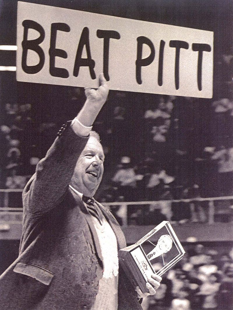 "Jack Fleming holds ""Beat Pitt"" sign"