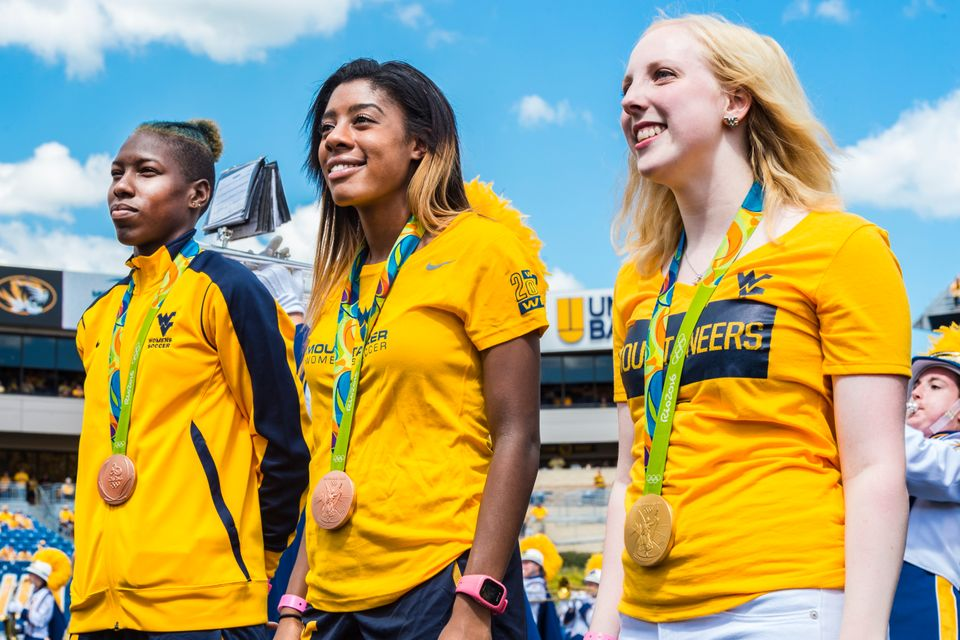 Photo of three Olympians - Kadeisha Buchanan, Ashley Lawrence and Ginny Trasher