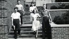 Students walking down steps