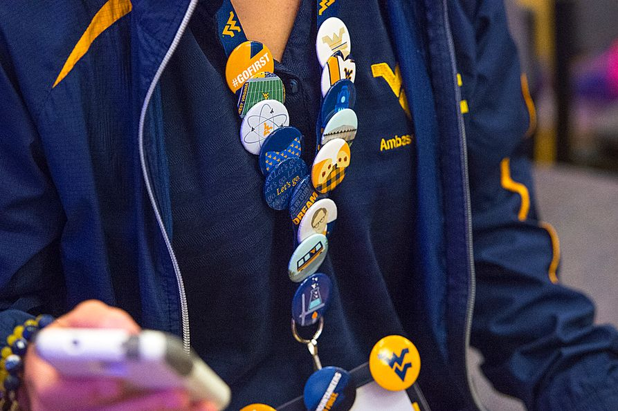 A student wearing tens of buttons on a name tag
