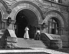 Two students on steps of Stewart Hall