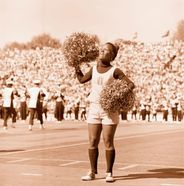 Female cheerleader at old Mountaineer Field