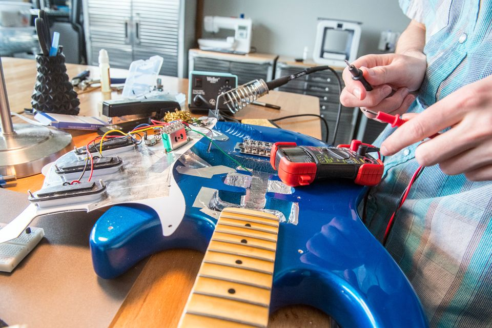 A student working on a guitar