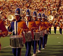 Drummers marching on Mountaineer Field