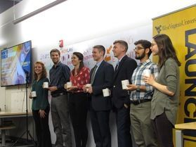(left to right) Courtney Burgazli, Joshua Lonnes, Ashley Reece, Johnny McFadden, Andrew Wilson, Nima Shahabshahmir and Alison Sommer pitched their business/organization concepts to a panel of judges in the WVU LaunchLab