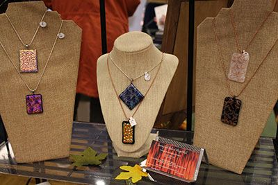 Jewelry displayed by an artisan at the Arts & Craft Fair