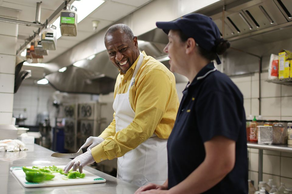 WVU employees work together in kitchen