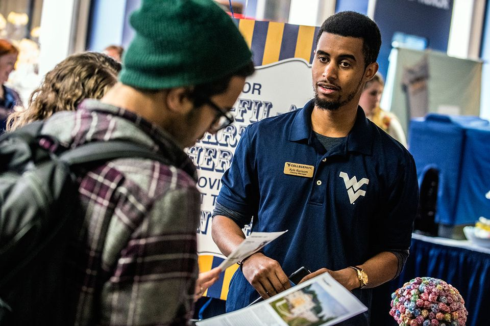 WVU employee talking to student