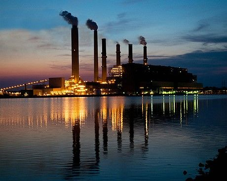 Indiana Gibson Generating Station by Duke Energy reflection in the water with a sunset
