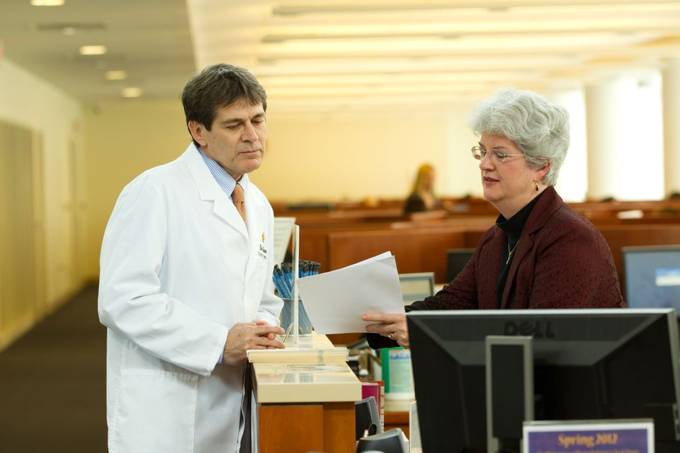 librarian consulting with doctor