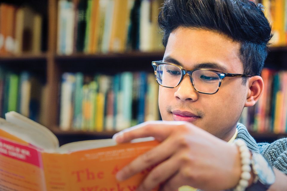 Close up of a student reading a book