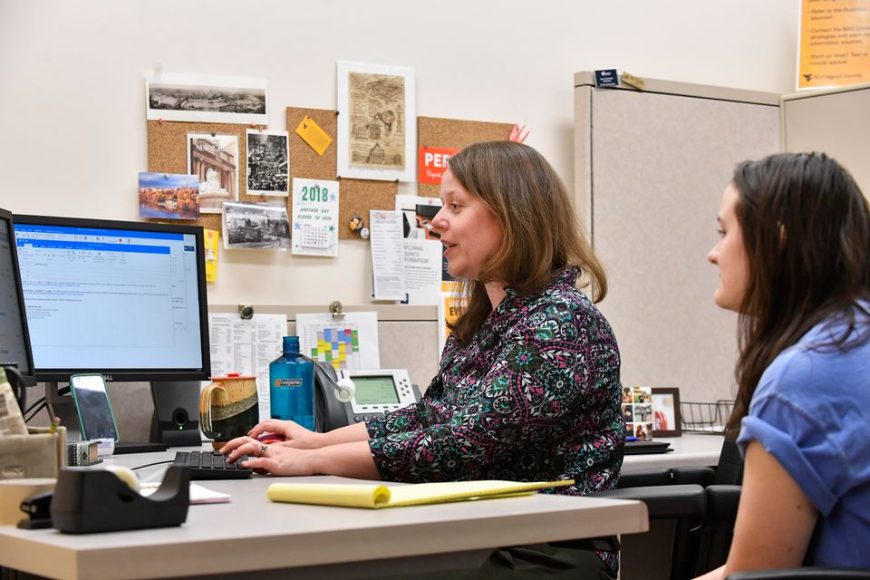 librarian and student in office during research consultation