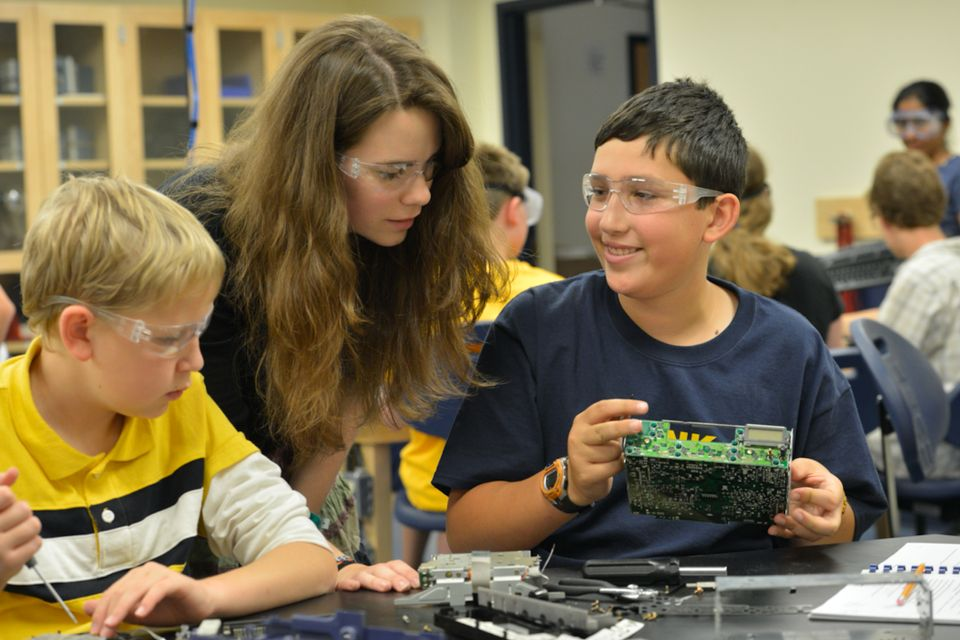 Instructor oversees students participating in STEM camp activities