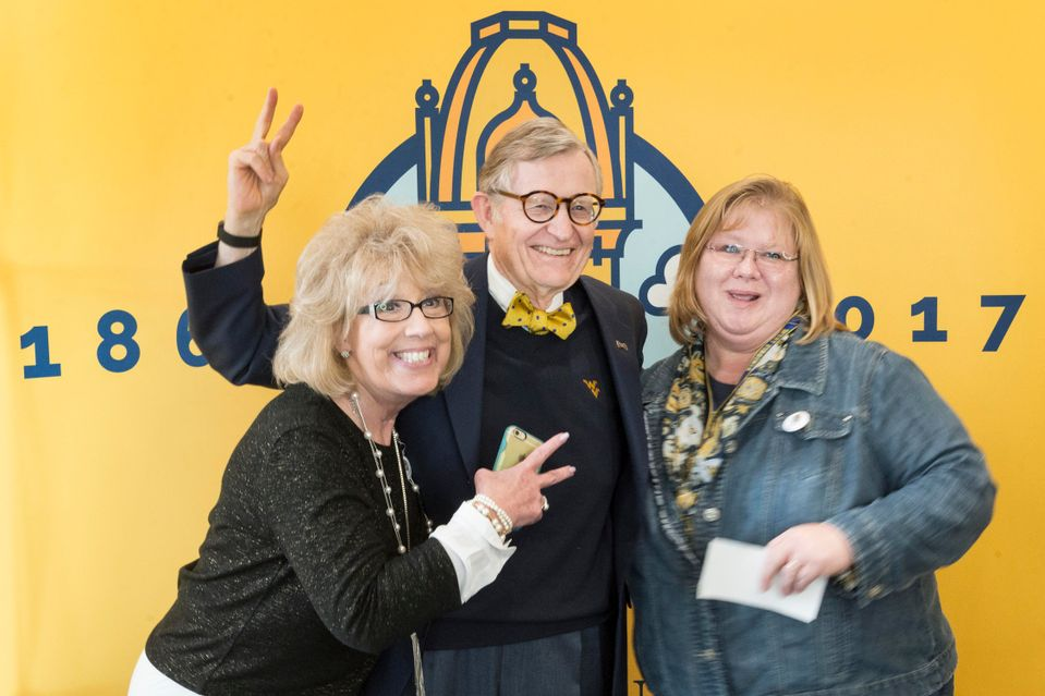 WVU employees pose with President Gee
