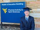 Ryan Stamski sport management graduation photo at CPASS building.