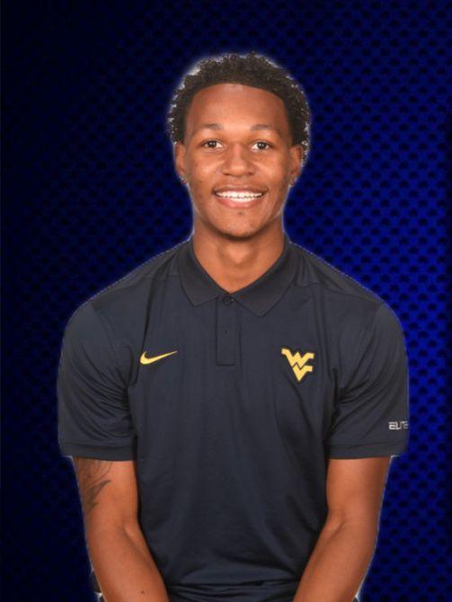 Myles Washington portrait style photo, wearing dark blue WVU branded shirt.