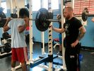 Ryan Wood teaching a student to dead-lift.