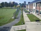 The College of Physical Activity and Sport Sciences during a sunny school day.