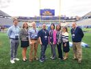 CPASS faculty standing on mountaineer field after being recognized