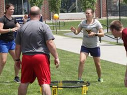 Katie tossing a ball with other students