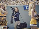 Videographer at football game