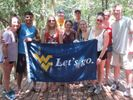 Students in Costa Rica holding a WVU Flag
