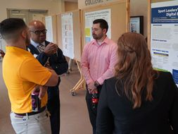 Dr. Floyd Jones talks to students regarding their research.