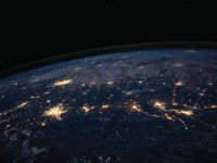 Photo of the earth at night from space that shows light pollution in cities.